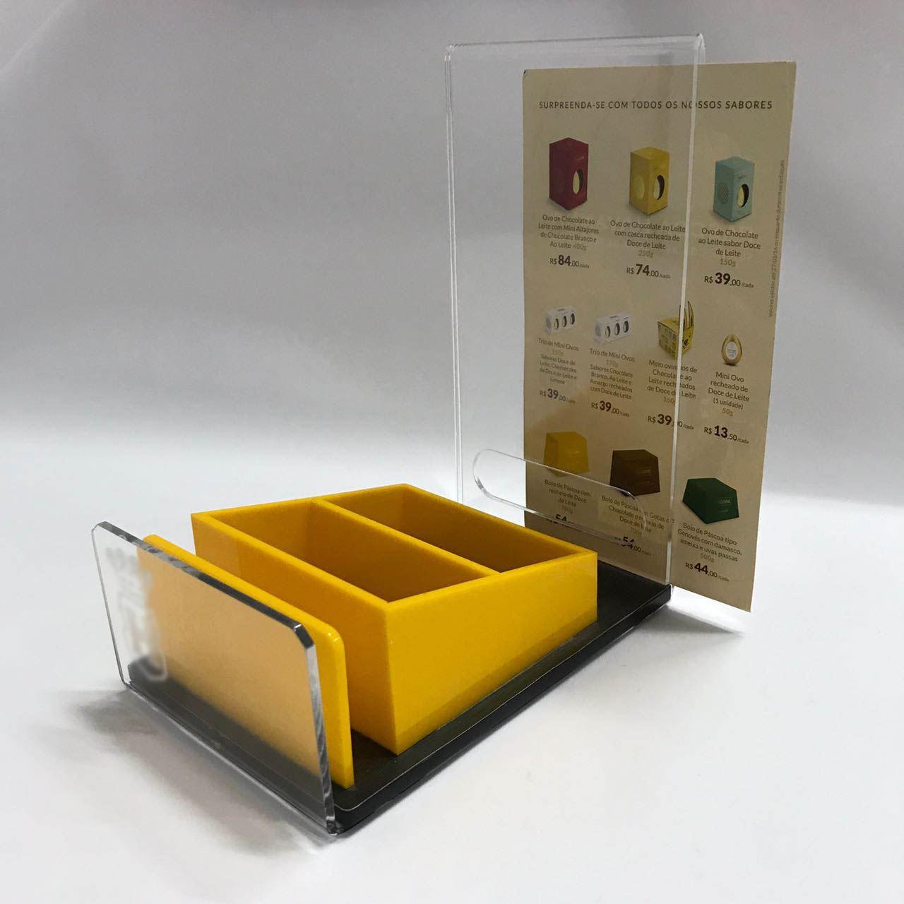 Display de mesa é uma peça promocional de pequeno porte para ser utilizada no PDV. Geralmente utilizado em balcões, em geral.